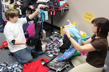 Volunteers sort items donated to Northeast Parent & Child Society's Holiday Hope Fund
